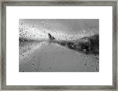 Rain On The Plane Framed Print