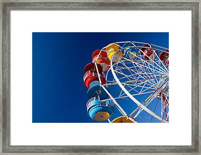 Rainbow Colored Carriages On Blue Framed Print