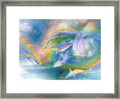 Rainbow Dolphins Framed Print by Carol Cavalaris