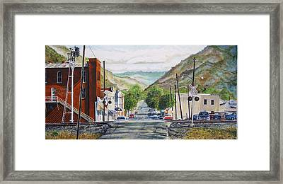 Rainbow In Rust Framed Print by Thomas Akers