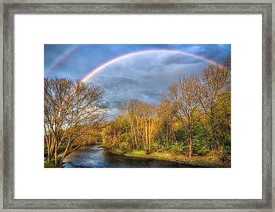 Framed Print featuring the photograph Rainbow Over The River by Debra and Dave Vanderlaan