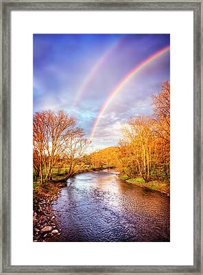 Framed Print featuring the photograph Rainbow Over The River II by Debra and Dave Vanderlaan