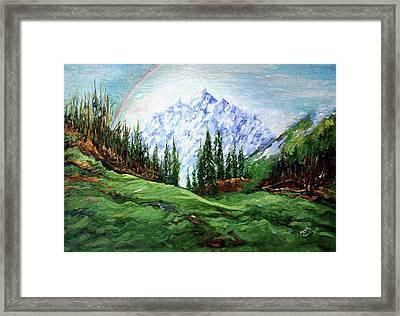 Rainbow Over The Snow Covered Mountain Framed Print