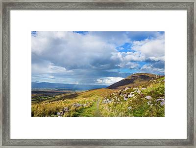Framed Print featuring the photograph Raining Down And Sunshine With Rainbow On The Countryside In Ire by Semmick Photo