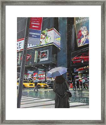 Rainy Day In Times Square Framed Print by Patti Mollica