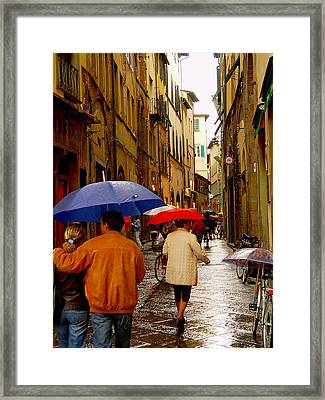 Framed Print featuring the photograph Rainy Day Shopping In Italy by Nancy Bradley