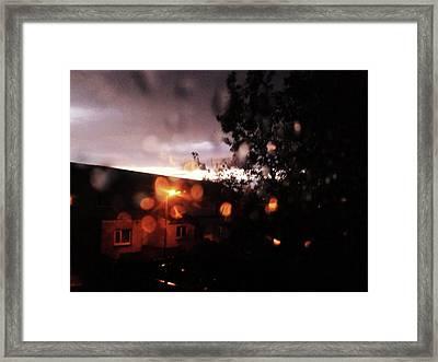 Rainy Sunset Framed Print by Chrisselle Mowatt