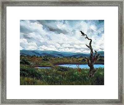 Raven In A Bleak Landscape Framed Print by Laura Iverson
