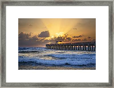 Rays Over The Pier Framed Print by Debra and Dave Vanderlaan
