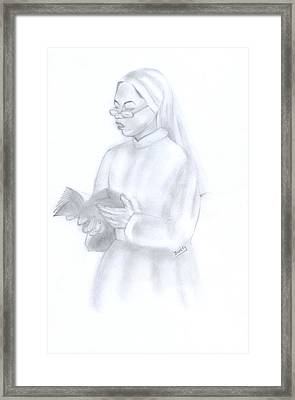 Reading African Nun Framed Print