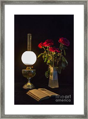 Framed Print featuring the photograph Reading By Oil Lamp by Brian Roscorla