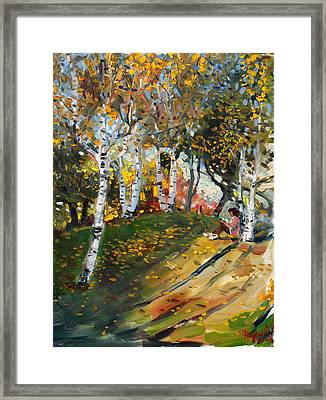 Reading In The Park  Framed Print by Ylli Haruni