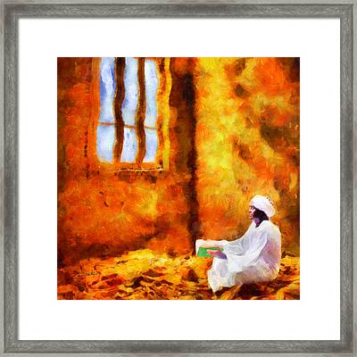 Reading The Quran Framed Print by George Rossidis