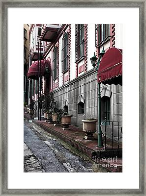 Red Awning Framed Print by John Rizzuto