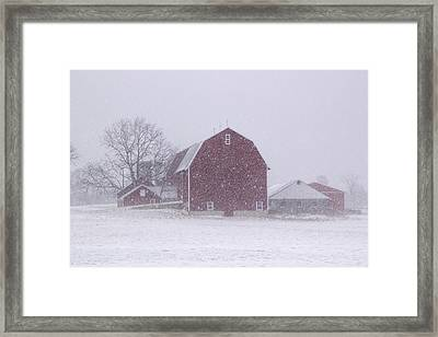 Red Barn In A Snowstorm Framed Print by Randall Nyhof