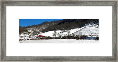 Red Barn In Snow Framed Print by Alan Lenk