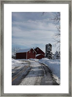 Red Barn In The Snow Framed Print