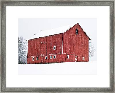 Red Barn Snow Storm  Framed Print by Tim Fitzwater
