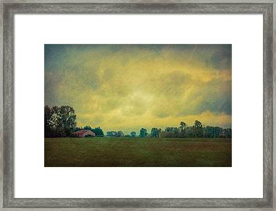 Red Barn Under Stormy Skies Framed Print