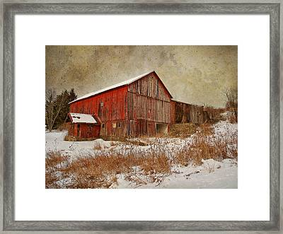 Red Barn White Snow Framed Print by Larry Marshall
