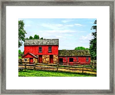 Red Barn With Fence Framed Print by Susan Savad