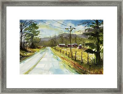 Red Barns On The Right Framed Print by Judith Levins