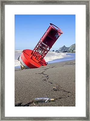Red Bell Buoy On Beach With Bottle Framed Print