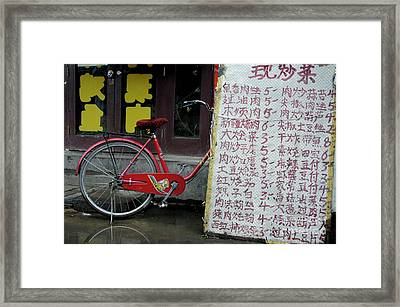 Red Bicycle In China Framed Print by Sami Sarkis