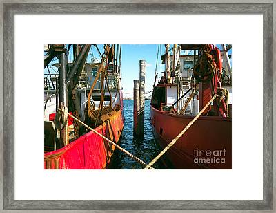 Framed Print featuring the photograph Red Boat Docked In The Bay by John Rizzuto