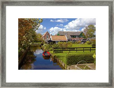 Red Boat On The Calm Water Of A Canal  Framed Print