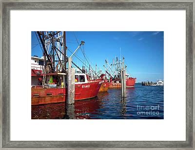 Framed Print featuring the photograph Red Boats In The Bay by John Rizzuto
