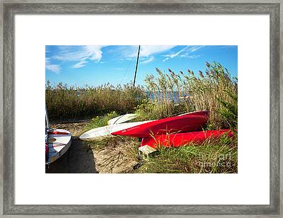 Framed Print featuring the photograph Red Boats On The Beach by John Rizzuto