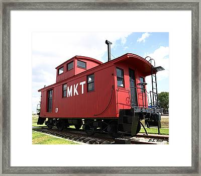 Red Caboose Framed Print by Dennis Stein