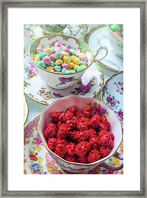 Red Candy In Tea Cup Framed Print