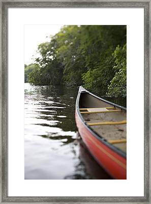 Red Canoe At Shoreline With Trees Framed Print by Gillham Studios