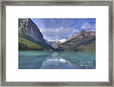 Red Canoe On Lake Louise Framed Print by Larry Whiting