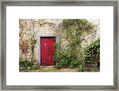 Red Door In Old Brick And Stone Cottage Framed Print by Jeremy Woodhouse