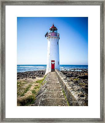 Red Door Lighthouse Framed Print by Perry Webster