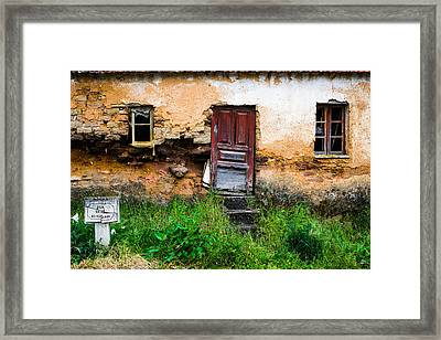 Red Door With No Number Framed Print