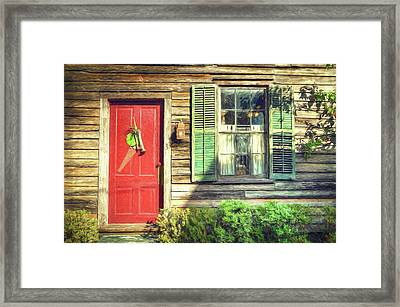 Red Door With Saw Framed Print by John Adams