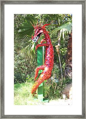 Red Dragon On Post Framed Print by Robert Findley