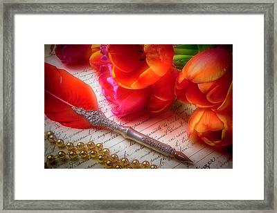 Red Feather Pen And Tulips Framed Print by Garry Gay