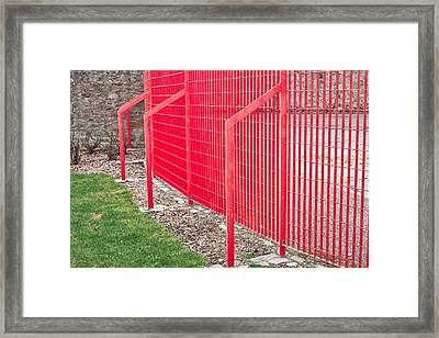 Red Fence Framed Print by Tom Gowanlock