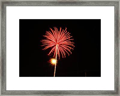 Red Fireworks Framed Print by Laura Catherine