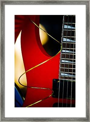 Red Guitar Framed Print by Hakon Soreide