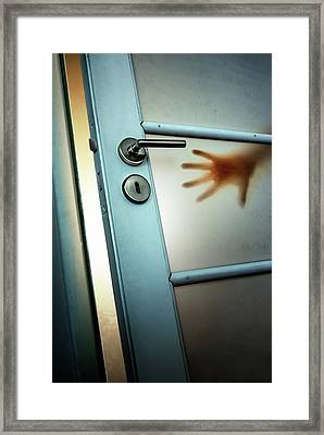 Red Hand On Door Framed Print by Carlos Caetano