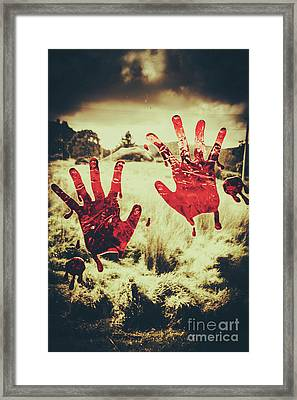 Red Handprints On Glass Of Windows Framed Print