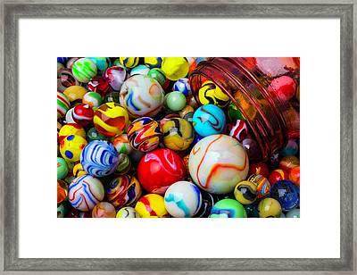 Red Jar Spilling Marbles Framed Print by Garry Gay