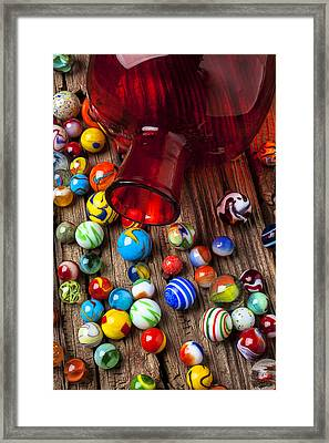 Red Jar With Marbles Framed Print