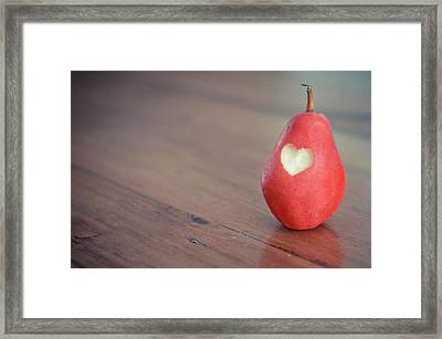 Red Pear With Heart Shape Bit Framed Print by Danielle Donders - Mothership Photography